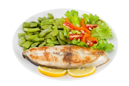 perca: fried fish with beans and salad on the plate on white background Stock Photo
