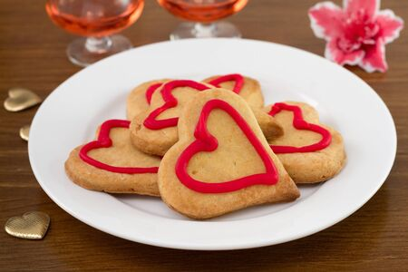 pink wine: cookies heart with pink wine Stock Photo