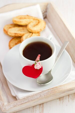 cup of coffee with heart and cookies photo