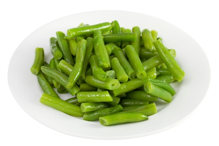 green beans on the plate on white background