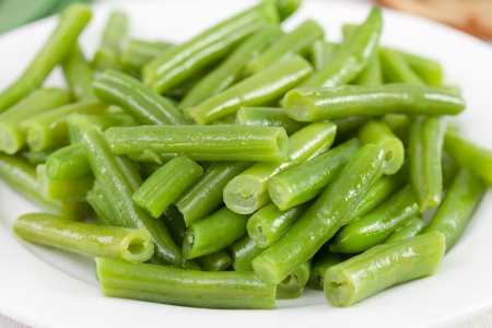 green bean: boiled green beans on the white plate