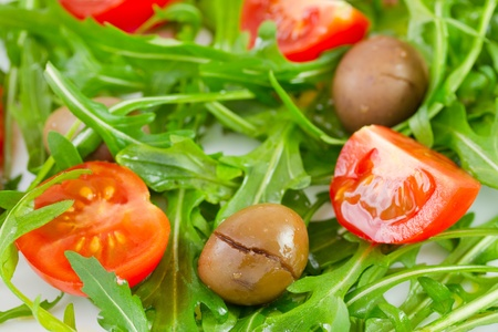 tomato cherry: rucola with green olives and tomato cherry Stock Photo