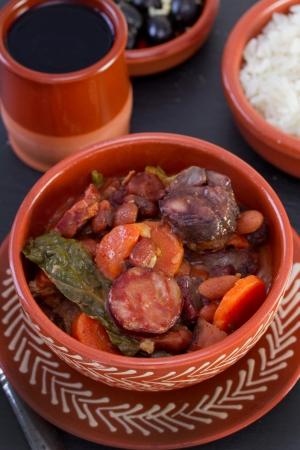 stew in ceramic bowl with rice and olives Stock Photo