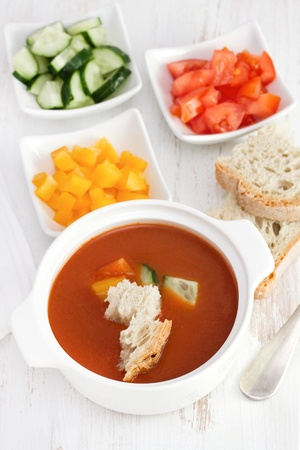 gaspacho: gaspacho with bread and vegetables in white bowl Stock Photo