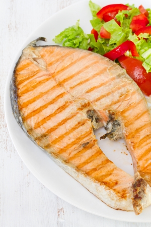 grilled salmon on dish Stock Photo