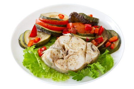 boiled fish with lettuce and vegetables Stock Photo
