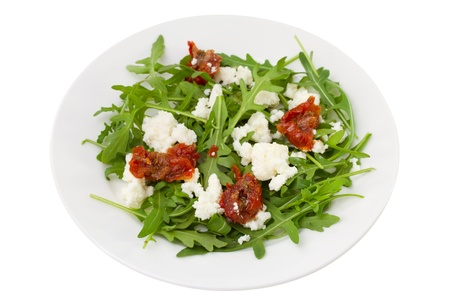 rucola with dry tomato and cheese