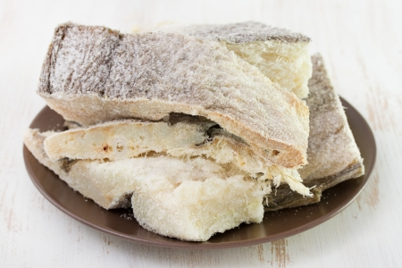 dry codfish on dark plate Stock Photo