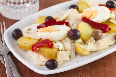 fish salad with olives and egg