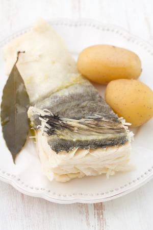 potato cod: cod fish with potato on plate