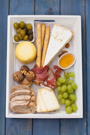 cheese platter: cheese platter on blue background