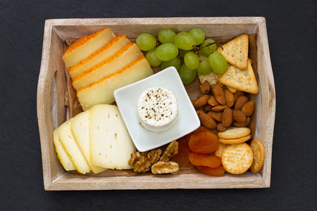 cheese platter: cheese platter on black background