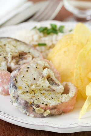 boiled fish with rice and chips