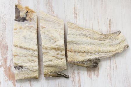 salt: salted cod fish on white background