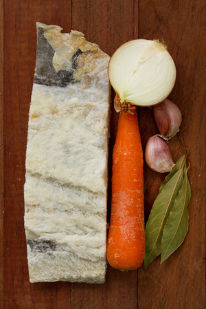 cod oil: salted cod fish with olive oil, carrot and garlic