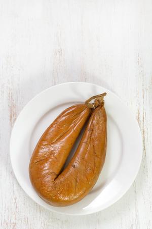 smoked sausage: smoked sausage on white plate