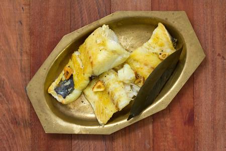 codfish: fried codfish on dish