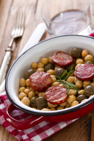 chick pea: chick pea with fried smoked sausages on dish Stock Photo