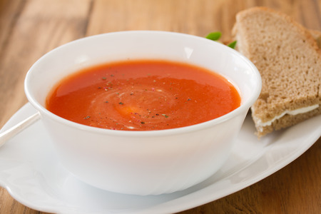 cold meal: tomato soup in white bowl with sandwich