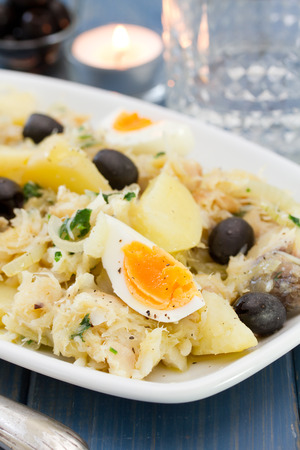 traditional portuguese dish with codfish on white dish Imagens