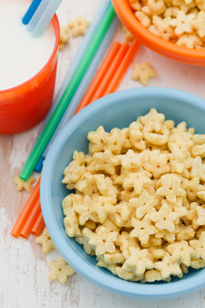 lifestile: corn flakes in blue bowl on white wooden background Stock Photo