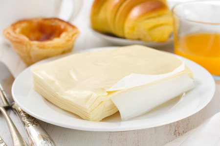 nata: cheese on plate with pastel de nata, juice and coffee
