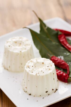 piri: fresh cheese with pepper on white plate Stock Photo