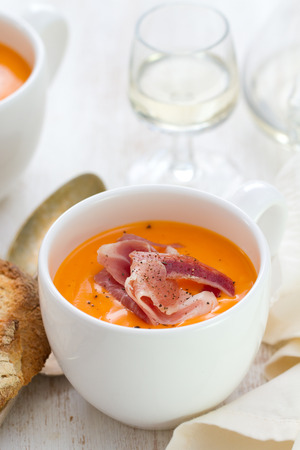 andalusian cuisine: cold soup with smoked meat in white cup with wine and spoon Stock Photo