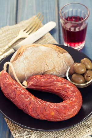 smoked sausage chourico with bread and olives