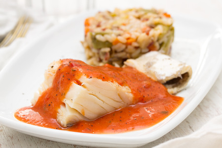 boiled cod fish with sauce and rice