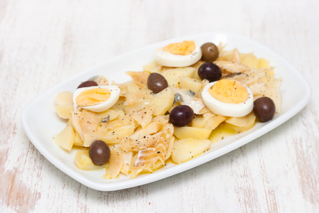 Cod fish with potato, egg and olives