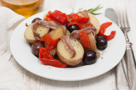 Anchovies with potato and olives Stock Photo