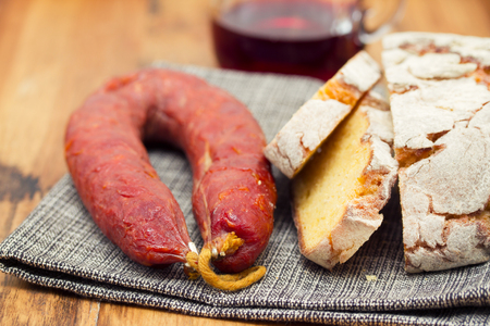 smoked sausage with corn bread on wooden background