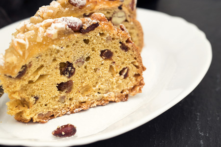 fruit cake with nuts on white dish