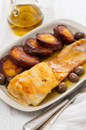 fried cod fish with sweet potato on white dish