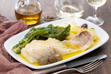 cod fish with cabbage and potato on white dish