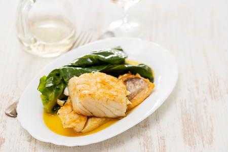 cod fish with vegetables on dish Stock Photo