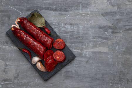 spanish smoked sausage chorizo on black ceramic board