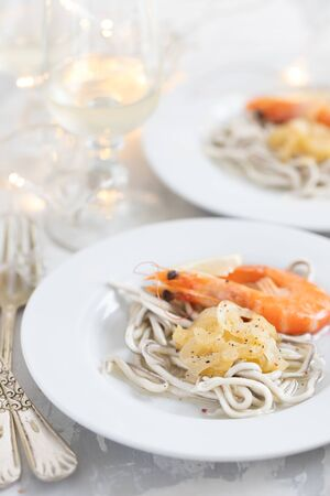 Traditional Spanish food. Gulas with oil and shrimp on white plate. Reklamní fotografie