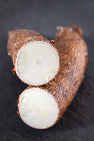 raw cassava on ceramic background