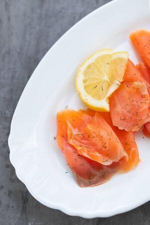 salted salmon with lemon on white dish Banco de Imagens