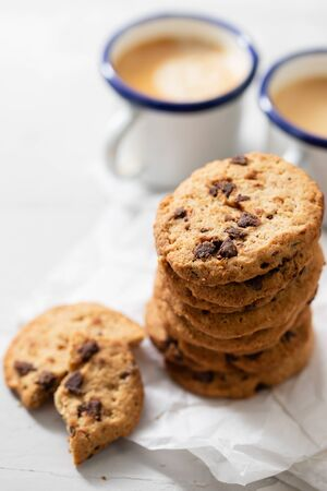 coffee and cookies with chocolate chips on ceramic background Stock Photo