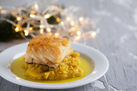 cod fish with sweet potato and olive oil on white dish Imagens