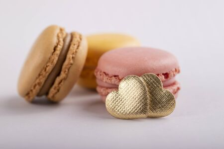 delicious colorful macaroons with heart on gray background 写真素材