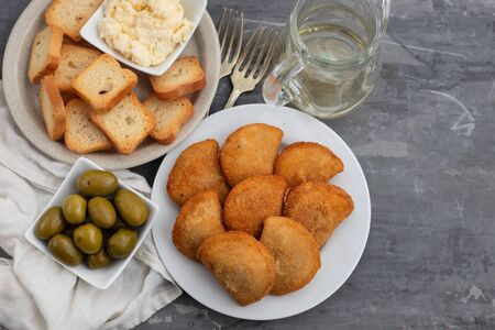 typical portuguese snack with meat rissois de carne on ceramic background