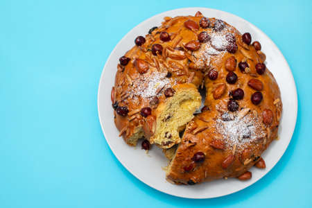 typical portuguese fruit cake Bolo rainha on white dish