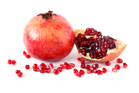 Ripe pomegranate fruit and its half with seeds on white background. Vegetarian Concept, Organic Vitamins. Organic and Benefit Garnet Fruit. Stock Photo