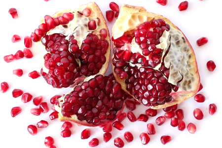 pomegranate seeds isolated on white background, view from above. Vegetarian Concept, Organic Vitamins. Organic and Benefit Garnet Fruit.