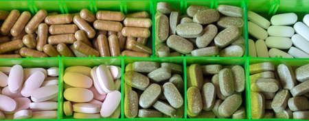 Tablet container is filled with medicine. View from above. Global healthcare concept. Pharmaceutical industry. Pharmacy.