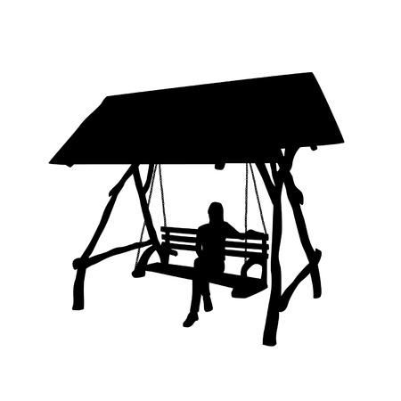 chain swing ride: Silhouette of a woman sitting on a swin